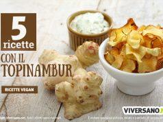 Topinambur fresco e chips di topinambur sopra un tavolo