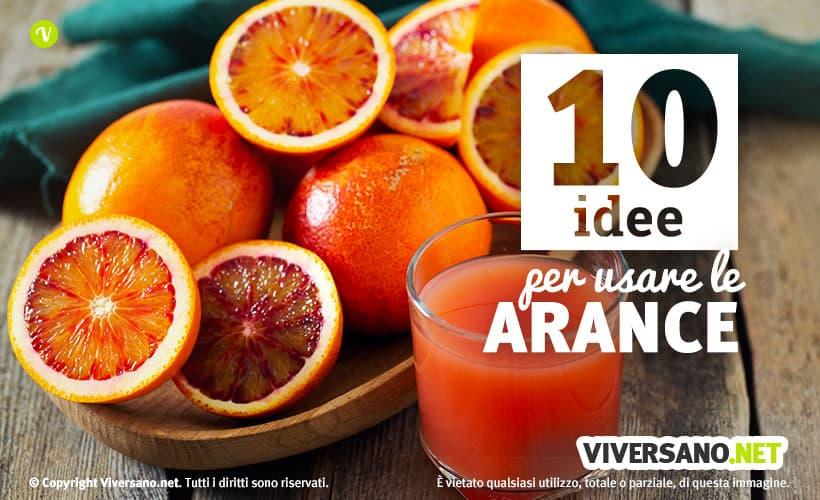 Arance tagliate e bicchiere con succo di arancia