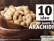 Immagine di arachidi con guscio poste in una ciotola di legno