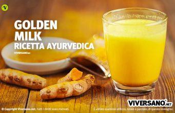 Bicchiere di Golden Milk con curcuma fresca sopra un tavolo