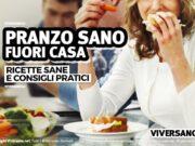 Donna che pranza al lavoro con pasto sano